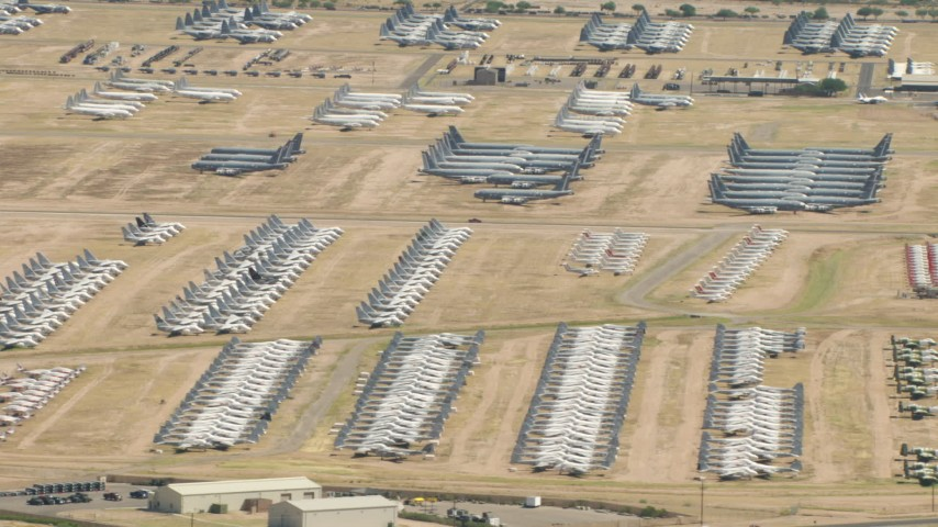 An aircraft boneyard with military planes at Davis Monthan AFB, Tucson, Arizona Aerial Stock Footage | AF0001_000855