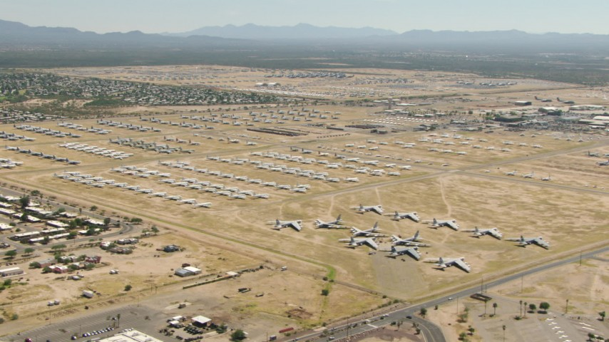 Neat rows of military airplanes at an aircraft boneyard, Davis Monthan AFB, Tucson, Arizona Aerial Stock Footage | AF0001_000858