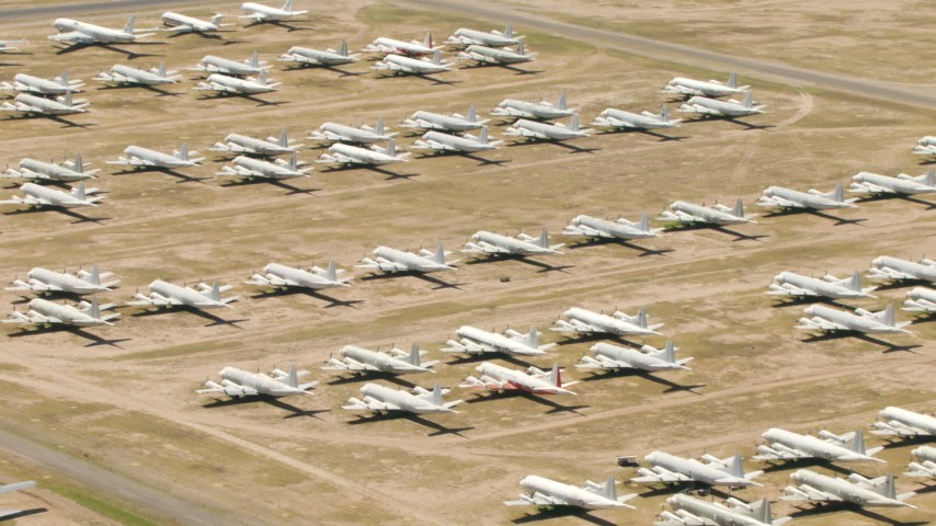 Military propellor airplanes at the aircraft boneyard, Davis Monthan AFB, Tucson, Arizona Aerial Stock Footage | AF0001_000860