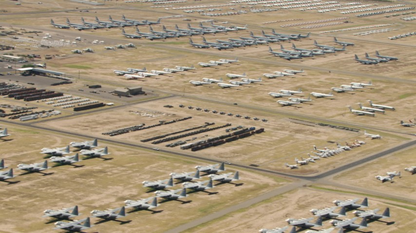 Groups of military airplanes at the base's aircraft boneyard, Davis Monthan AFB, Tucson, Arizona Aerial Stock Footage | AF0001_000862