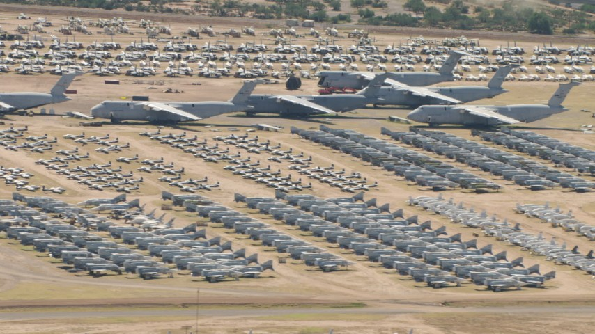 Military airplanes of various sizes at the base's aircraft boneyard, Davis Monthan AFB, Tucson, Arizona Aerial Stock Footage | AF0001_000863