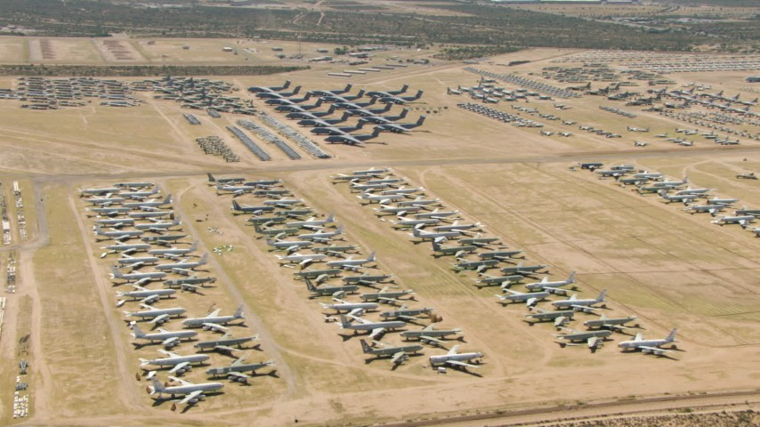 Various military airplanes at the base's aircraft boneyard, Davis Monthan AFB, Tucson, Arizona Aerial Stock Footage | AF0001_000864