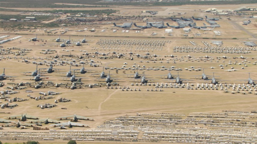 HD stock footage aerial video of airplanes at the base's aircraft boneyard, Davis Monthan AFB, Tucson, Arizona Aerial Stock Footage | AF0001_000866