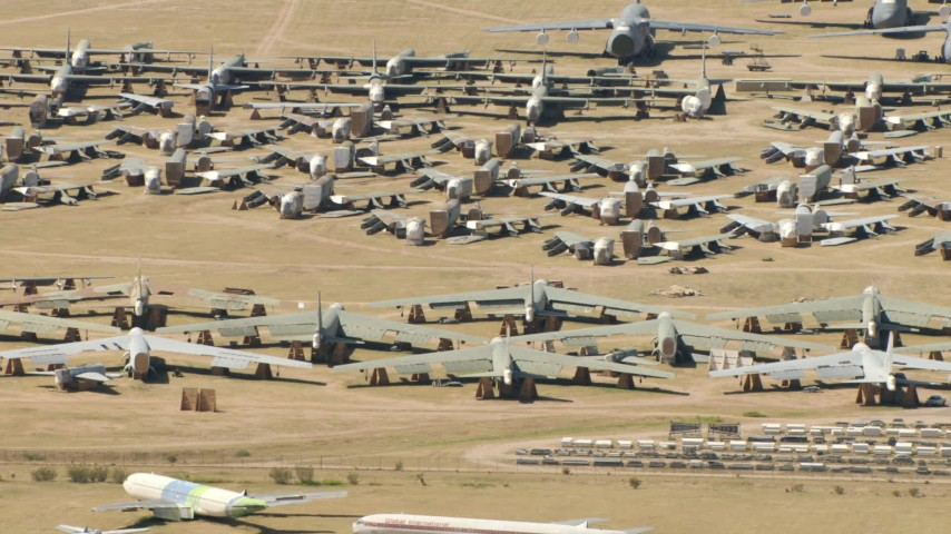 Reverse view of military airplanes at an aircraft boneyard, Davis Monthan AFB, Tucson, Arizona Aerial Stock Footage | AF0001_000867