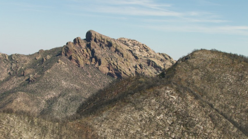 HD stock footage aerial video of flying by a rocky mountain peak in the Arizona desert Aerial Stock Footage | AF0001_000876