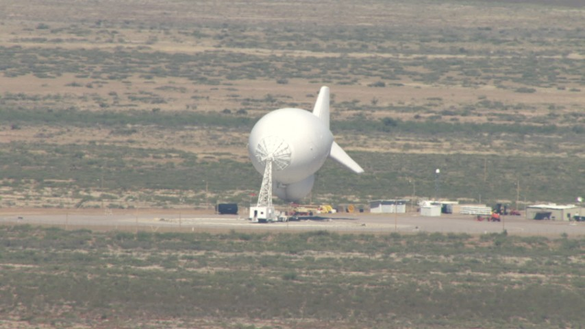 A blimp at an airfield in the Arizona Desert Aerial Stock Footage | AF0001_000883