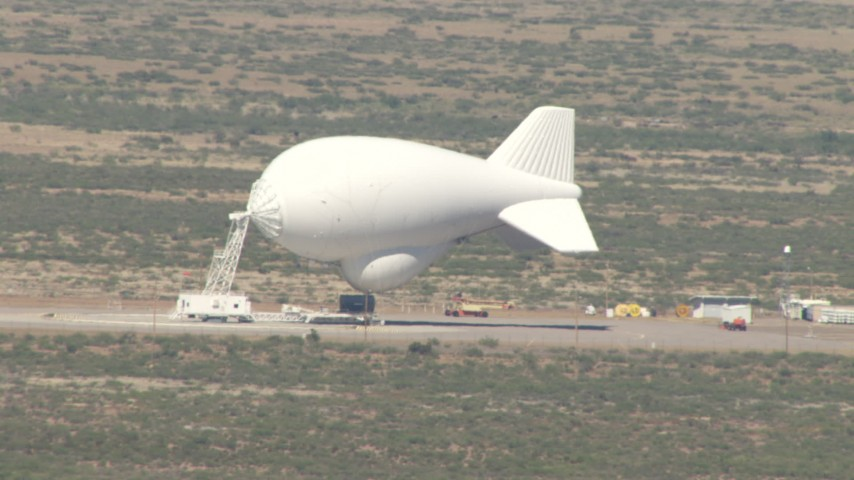 HD stock footage aerial video flyby a small blimp at an airfield in the Arizona Desert Aerial Stock Footage | AF0001_000885