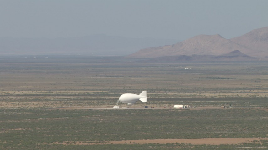 HD stock footage aerial video of a small desert airfield and a blimp in the Arizona Desert Aerial Stock Footage | AF0001_000887