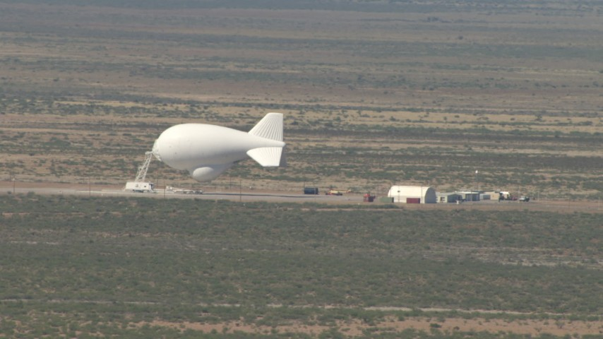 A blimp at an airfield in the Arizona Desert Aerial Stock Footage | AF0001_000888