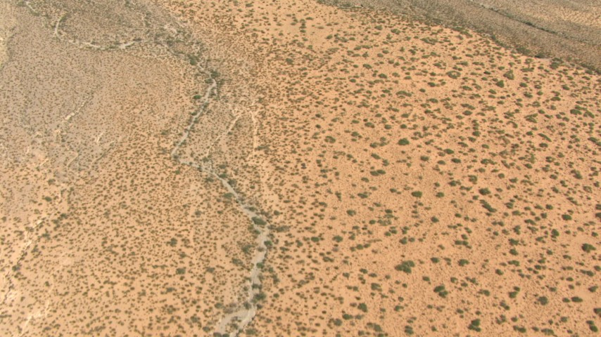 Bird's eye view of dry desert creek beds, New Mexico Aerial Stock Footage | AF0001_000890