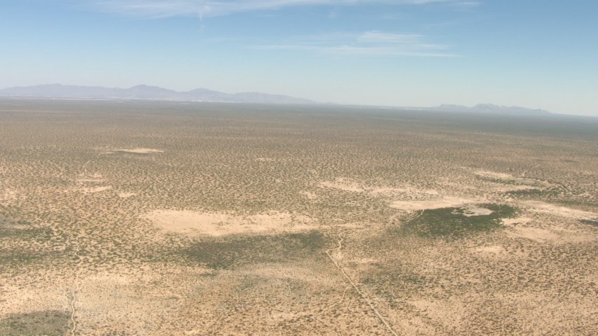 HD stock footage aerial video of flying over a wide desert plain in New Mexico Aerial Stock Footage | AF0001_000893