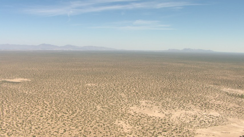 A wide desert plain in New Mexico Aerial Stock Footage | AF0001_000894