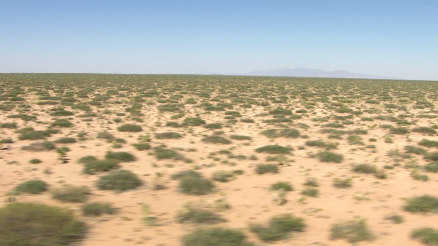 HD stock footage aerial video flyby desert vegetation in a wide plain in New Mexico Aerial Stock Footage | AF0001_000903