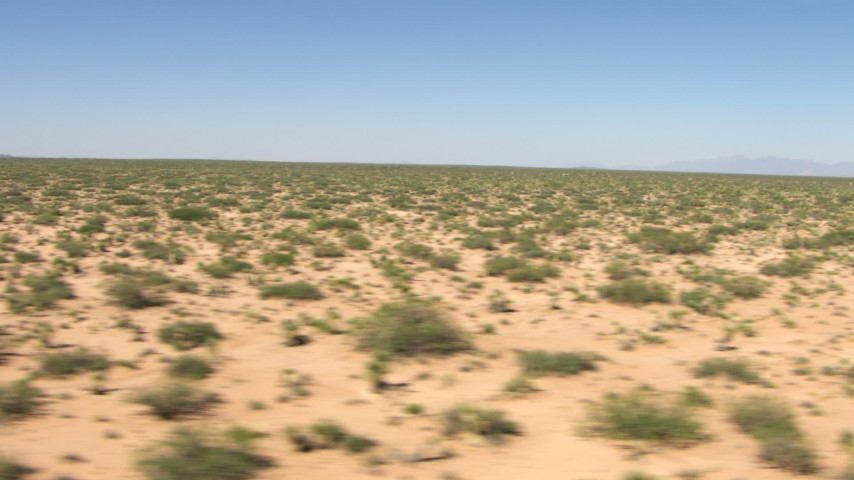 Flyby a wide desert plain in New Mexico Aerial Stock Footage | AF0001_000904