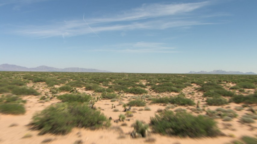A low altitude flight over a wide desert plain in New Mexico Aerial Stock Footage | AF0001_000912