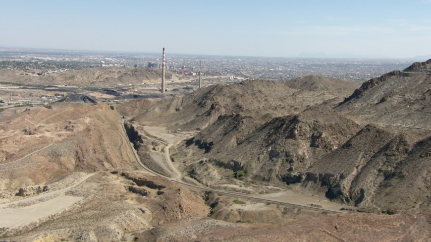 Passing a quarry to approach smoke stacks in El Paso, Texas Aerial Stock Footage | AF0001_000922