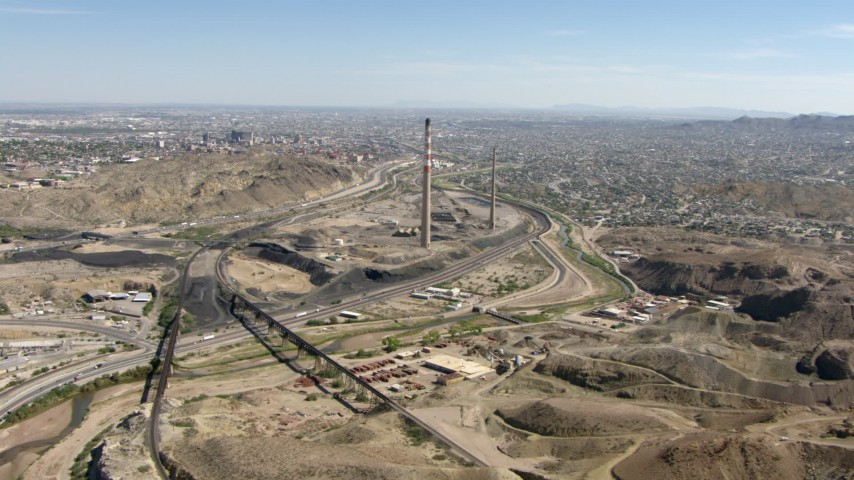 HD stock footage aerial video fly over a quarry and Highway 85 past smoke stacks to approach I-10 in El Paso, Texas Aerial Stock Footage | AF0001_000924