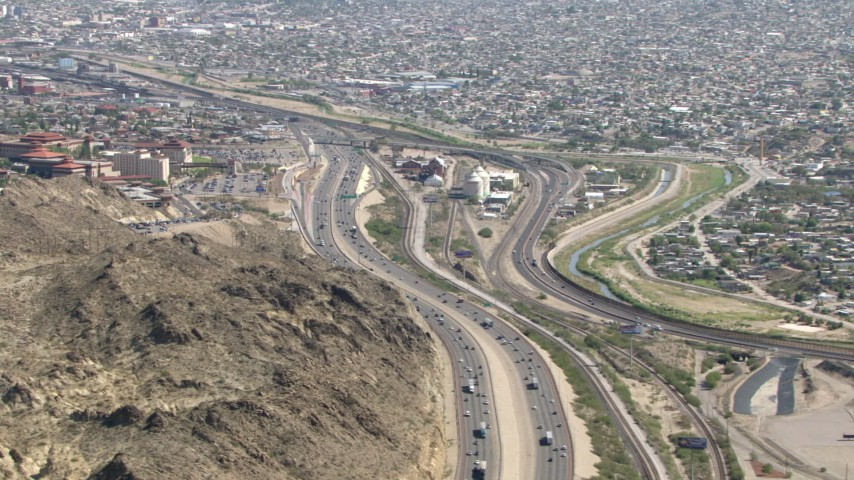 HD stock footage aerial video flyby I-10 and rugged hillside near a densely populated area, El Paso, Texas Aerial Stock Footage | AF0001_000926