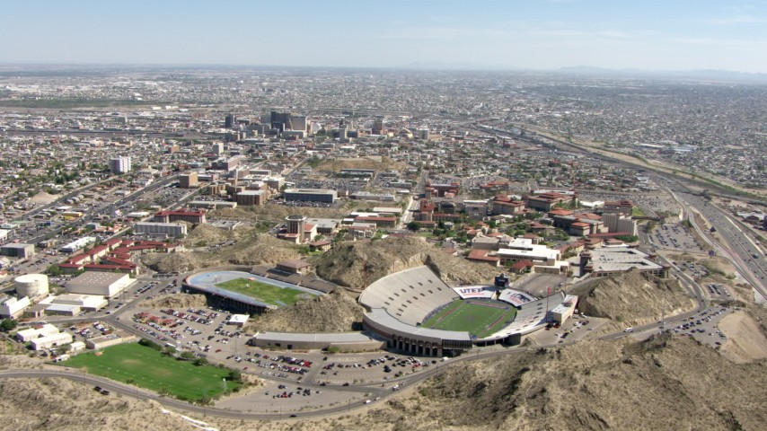 Fly over Sun Bowl Stadium and the University of Texas El Paso, El Paso, Texas Aerial Stock Footage AF0001_000927 | Axiom Images