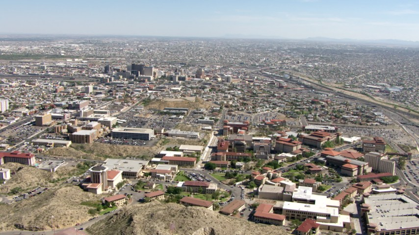 Fly over the University of Texas El Paso to approach Downtown El Paso, Texas Aerial Stock Footage | AF0001_000928