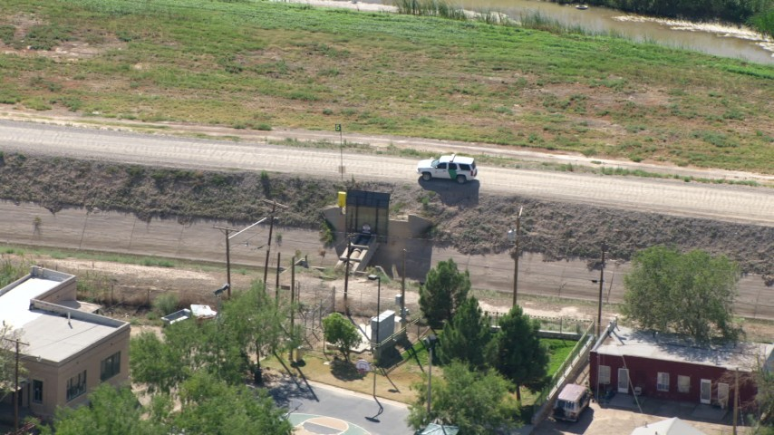 HD stock footage aerial video of a border patrol SUV parked on dirt road, El Paso, Texas Aerial Stock Footage | AF0001_000929