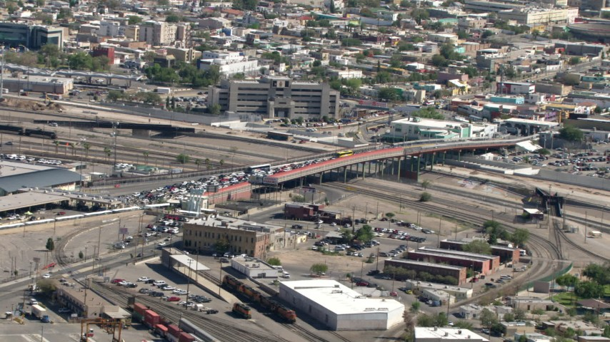 Approach the Paso del Norte International Bridge / Santa Fe Street Bridge on the El Paso/Juarez Border  Aerial Stock Footage AF0001_000930 | Axiom Images