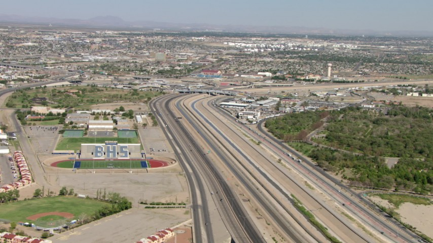 Bridge of the Americas and Bowie High School sports fields, El Paso/Juarez Border Aerial Stock Footage | AF0001_000933
