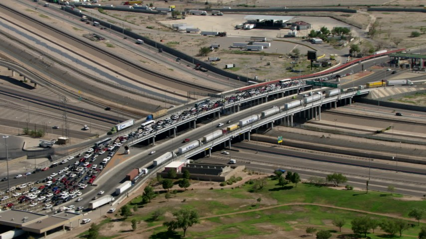 Heavy traffic crossing the Bridge of the Americas, zoom out to a wider view, El Paso/Juarez Border Aerial Stock Footage AF0001_000935