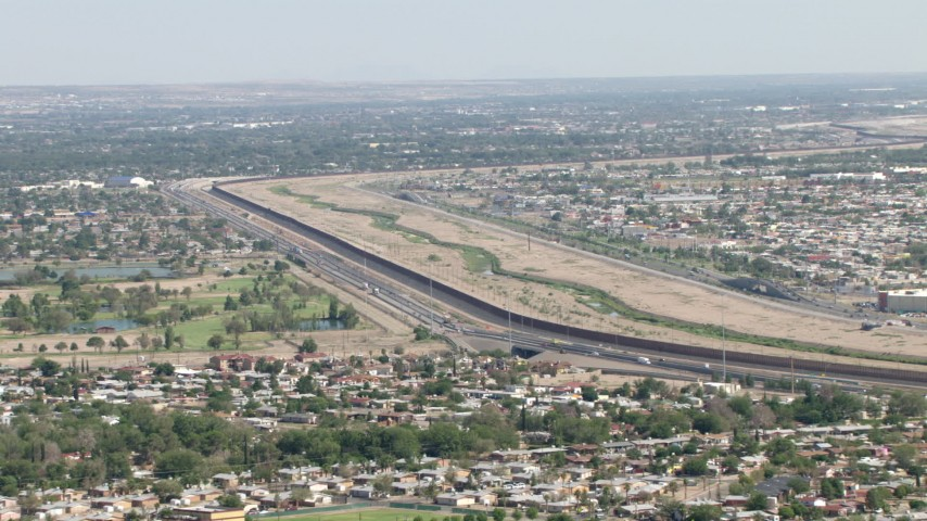 Highway 375 and the fence on US/Mexico border, El Paso, Texas Aerial Stock Footage AF0001_000941 | Axiom Images