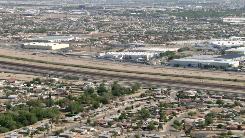 The fence on the US/Mexico border, seen from El Paso, Texas Aerial Stock Footage | AF0001_000943