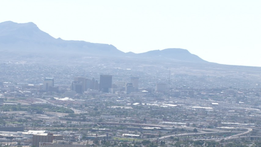 HD stock footage aerial video of city buildings and a view of the Franklin Mountains in Downtown El Paso, Texas Aerial Stock Footage | AF0001_000947