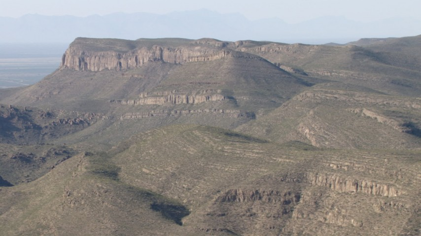 Passing a barren mountain range near El Paso, Texas Aerial Stock Footage | AF0001_000949