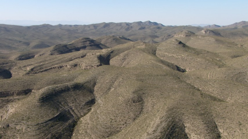 Flying by dry mountains near El Paso, Texas Aerial Stock Footage | AF0001_000950