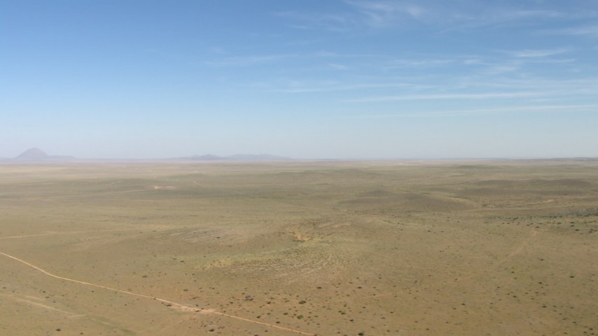 Flyby a wide desert plain near El Paso, Texas Aerial Stock Footage | AF0001_000954