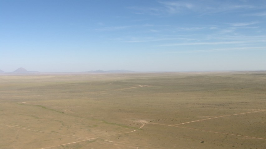 Flyby a wide arid plain near El Paso, Texas Aerial Stock Footage | AF0001_000955