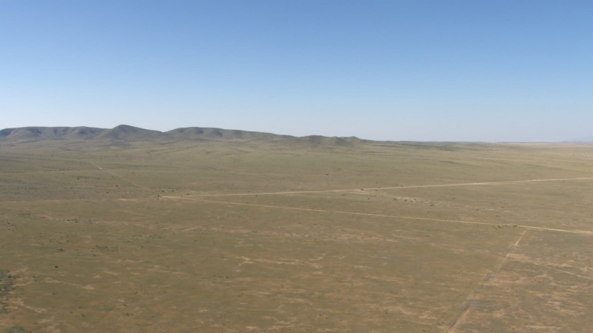 HD stock footage aerial video of a desert plain and hills near El Paso, Texas Aerial Stock Footage | AF0001_000956