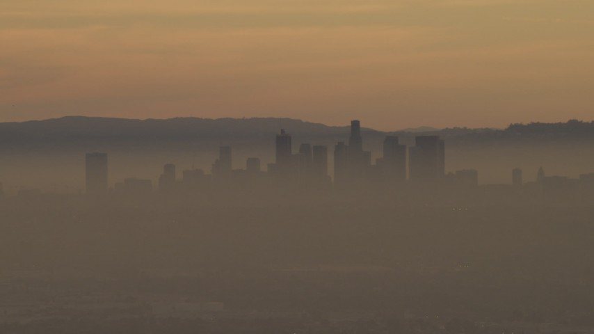 The Downtown Los Angeles skyline in haze at sunset, California  Aerial Stock Footage | AF0001_000978