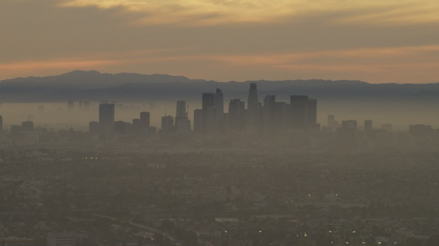 5K stock footage aerial video of a view of the Downtown Los Angeles skyline in haze at sunset, California Aerial Stock Footage | AF0001_000985