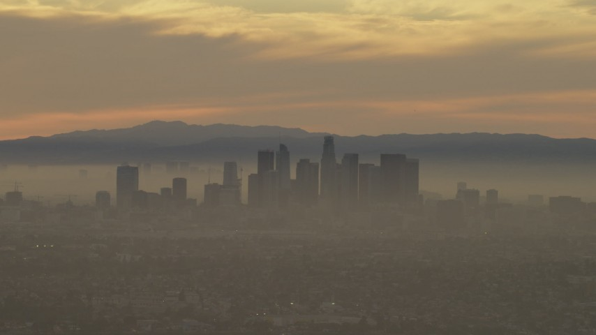The downtown los angeles skyline in haze at sunset california passing the downtown los angeles skyline in haze at sunset california aerial stock footage af0001000986 sciox Gallery