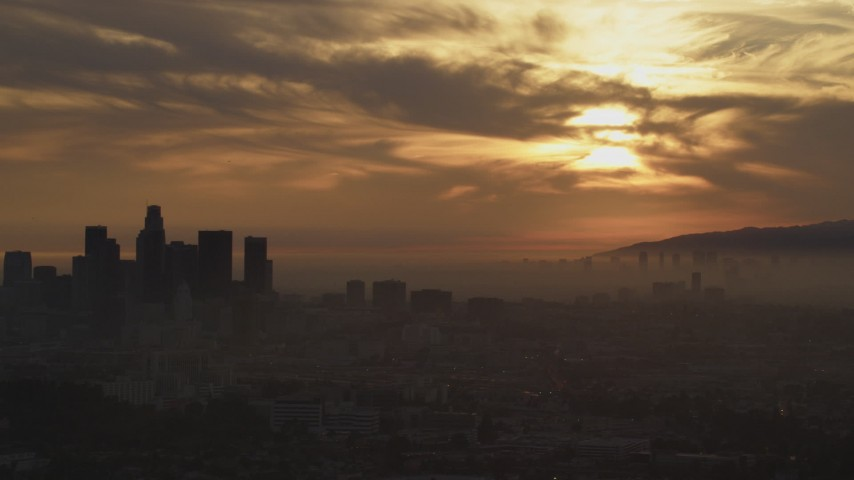 5K stock footage aerial video of part of the hazy Downtown Los Angeles skyline at sunset, California Aerial Stock Footage | AF0001_000991