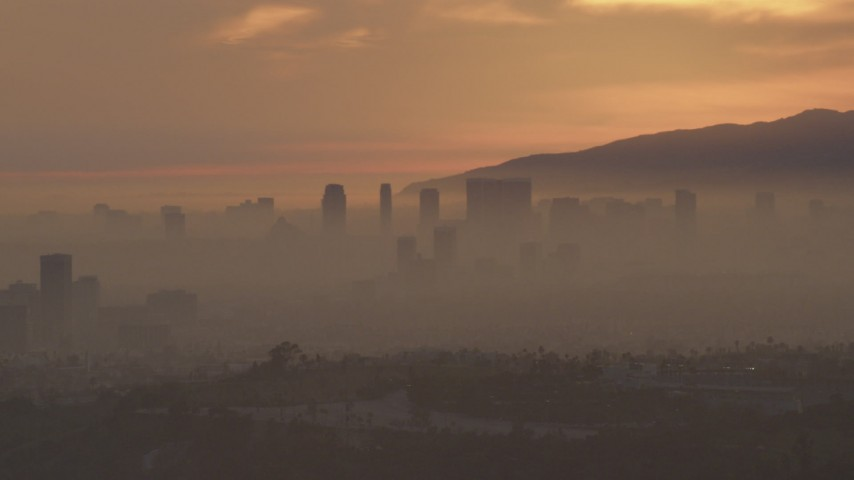 5K stock footage aerial video of Century City skyscrapers in haze at sunset, California Aerial Stock Footage | AF0001_000993