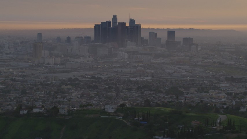 A view of Downtown Los Angeles skyline from the east at twilight, California  Aerial Stock Footage | AF0001_000994