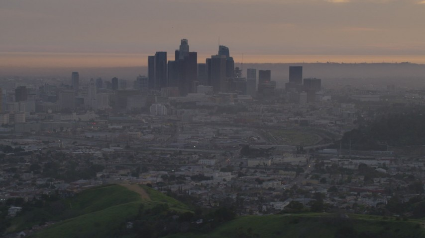 5K stock footage aerial video of a view west at the Downtown Los Angeles skyline at twilight, California Aerial Stock Footage | AF0001_000995