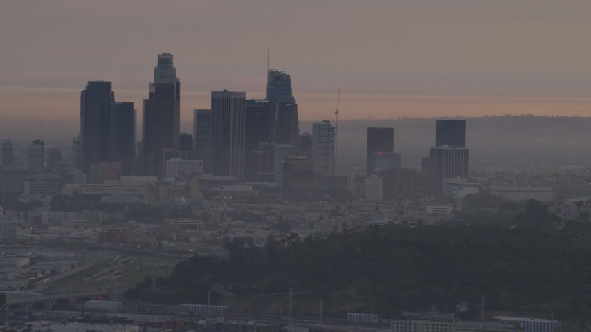 5K stock footage aerial video of the Downtown Los Angeles skyline seen from Dodger Stadium at twilight, California Aerial Stock Footage | AF0001_000996