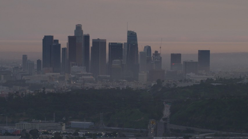 5K stock footage aerial video of the Downtown Los Angeles skyline seen from behind Dodger Stadium at twilight, California Aerial Stock Footage | AF0001_000997