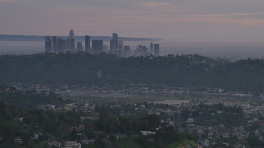 5K stock footage aerial video of Downtown Los Angeles skyline seen from hillside homes at twilight, California Aerial Stock Footage | AF0001_001001