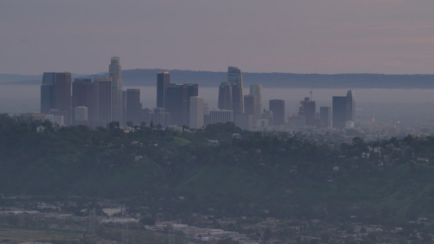 5K stock footage aerial video of Downtown Los Angeles skyline behind hilltop Echo Park homes at twilight, California Aerial Stock Footage | AF0001_001002