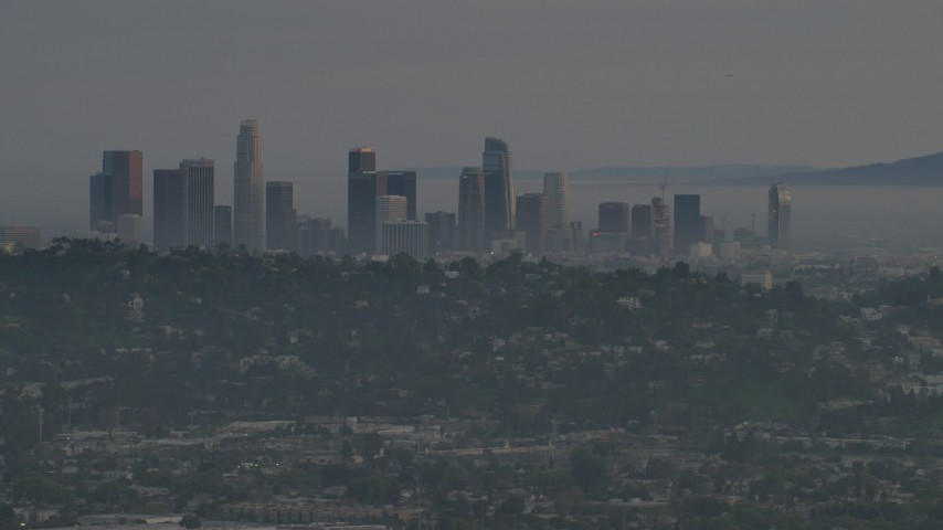 5K stock footage aerial video of a view of Downtown Los Angeles skyline and hillside homes in Silver Lake at twilight, California Aerial Stock Footage | AF0001_001004
