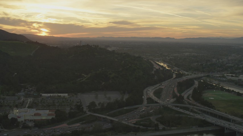 5K stock footage aerial video of heavy traffic on the I-5/ 134 interchange and the Los Angeles River at sunset, Glendale, California Aerial Stock Footage   AF0001_001006
