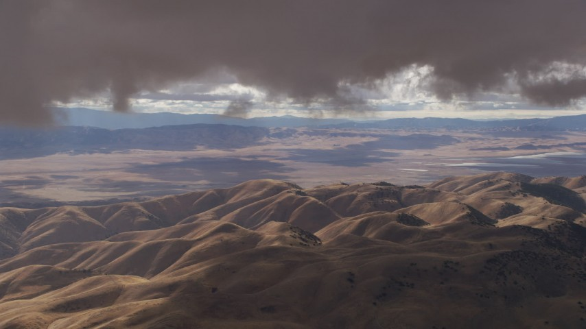 8K stock footage aerial video of low clouds over desert hills in Southern California Aerial Stock Footage | AF0001_001011